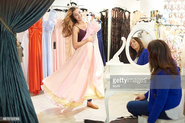shopping for that dress - evening wear stock pictures, royalty-free photos & images