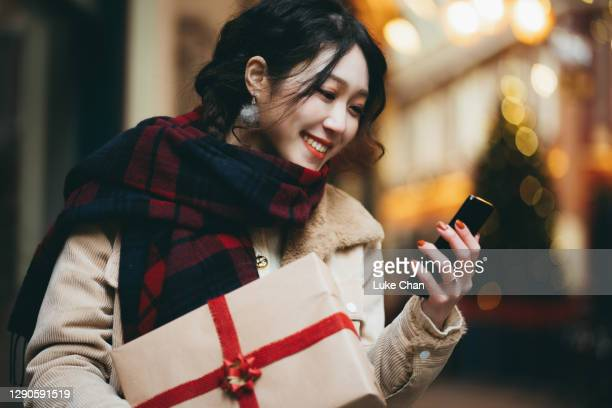 shopping for the holiday - business finance and industry stock pictures, royalty-free photos & images