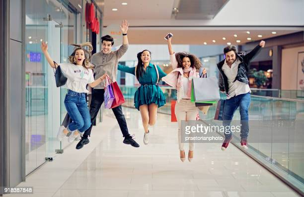 Shopping friends are jumping in the Mall