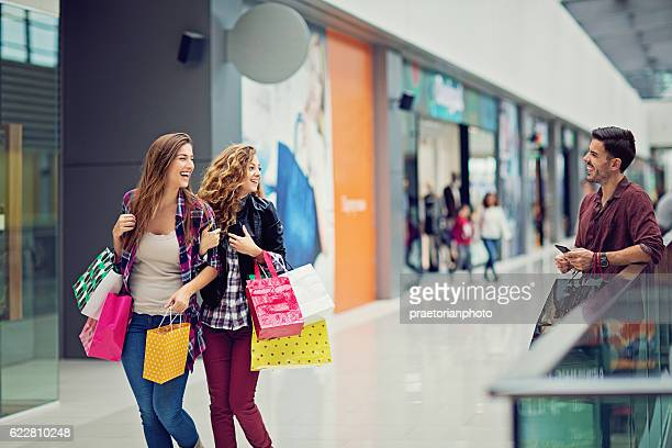 Shopping girls are flirting with a guy in Mall