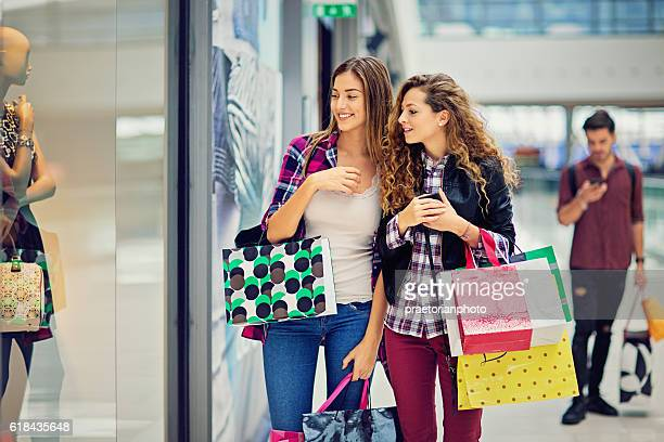 Shopping girls are looking dresses in Mall