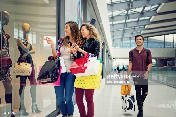 Shopping girls are looking dresses in the Mall