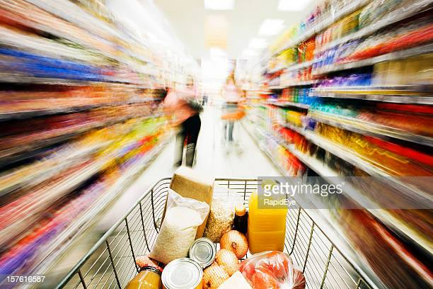 Shopping in a hurry: shelves blur as cart races past