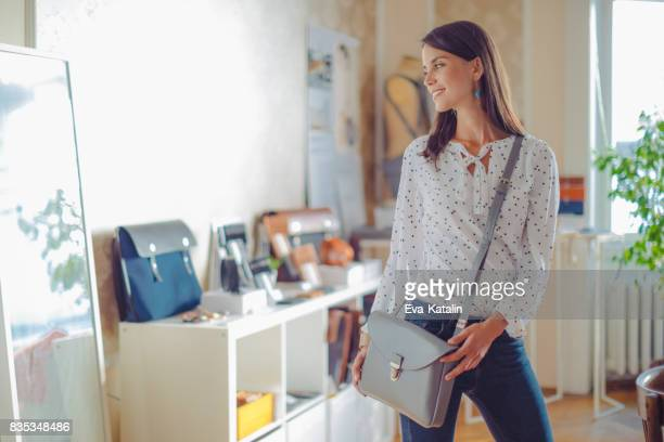 shopping in a showroom - clutch bag stock pictures, royalty-free photos & images