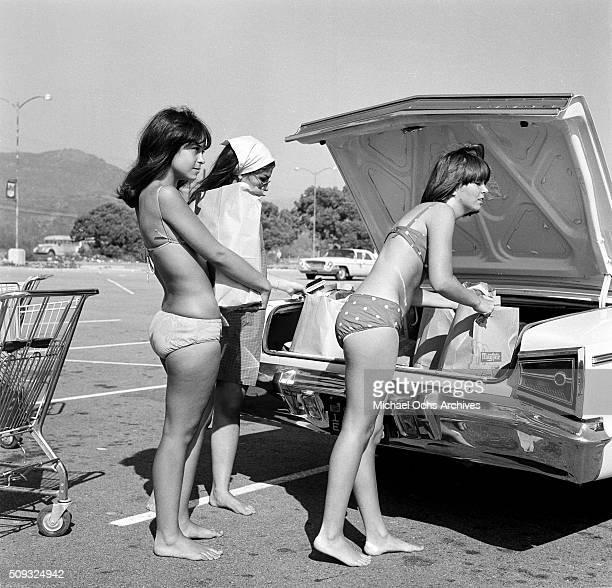 Shopping in a super market in Malibu is cooler in bikinis say Sue Bennett and Joy Calig 17 of San Fernando Valley at Malibu Beach Malibu California...