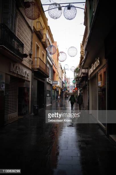 Shopping in Carrer de Mar Street, Rain, Badalona, Spain