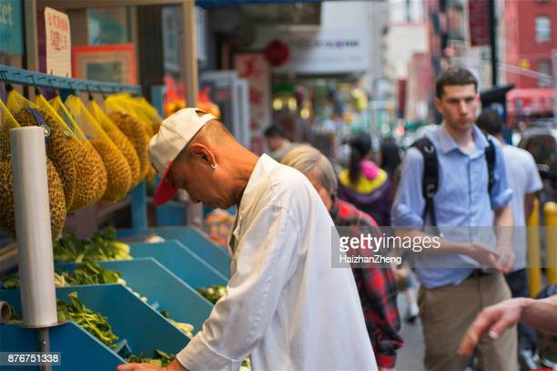 shopping in china town - new yorker building stock photos and pictures