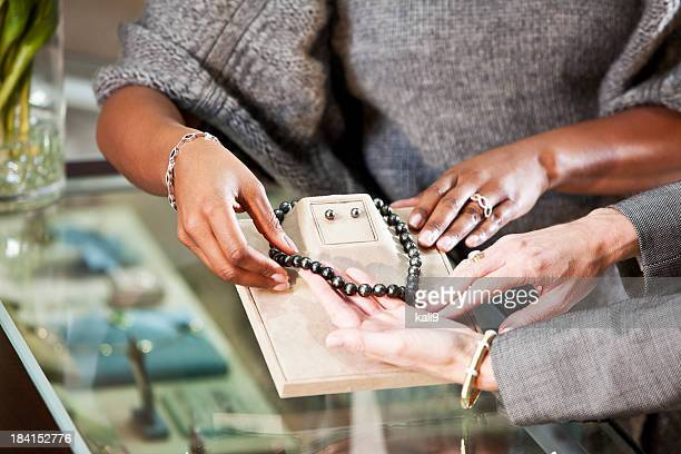 shopping in jewelry store - jewellery products stock photos and pictures