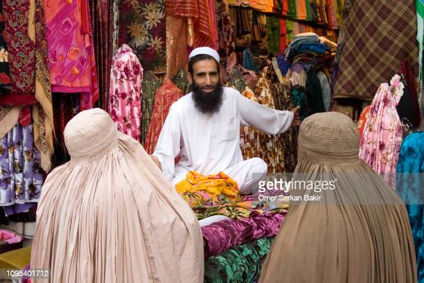 shopping in northern pakistan - afghanistan stock pictures, royalty-free photos & images
