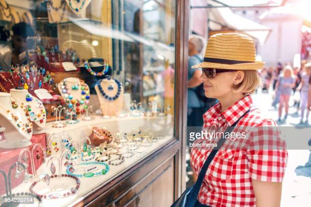 shopping in the street - murano stock pictures, royalty-free photos & images