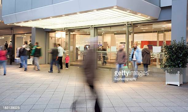 shopping mall entrance with people walking - entrance stock pictures, royalty-free photos & images
