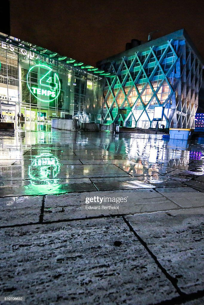 Shopping mall Les Quatre Temps and New Look shop reflecting into a puddle on February 13, 2016 in Paris La Defense, France.