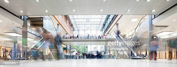 shopping mall with crowd of shoppers - shopping mall stock pictures, royalty-free photos & images