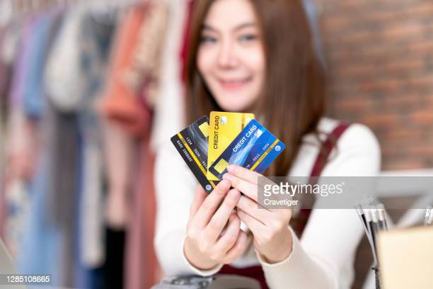 shopping online with  credit card on hand. - oresund region stock pictures, royalty-free photos & images