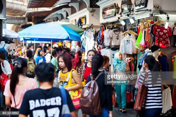 shopping people at dashion walk victory monument - menschengruppe stock pictures, royalty-free photos & images