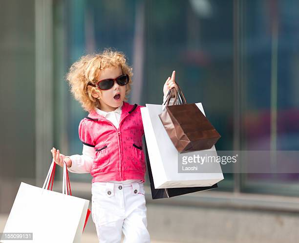shopping - little girls with no clothes on stock photos and pictures