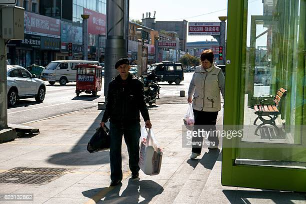 Shopping Russian people stroll on the street Hunchun is a city bordered with Russia Everyday many Russian people come here shopping their living...