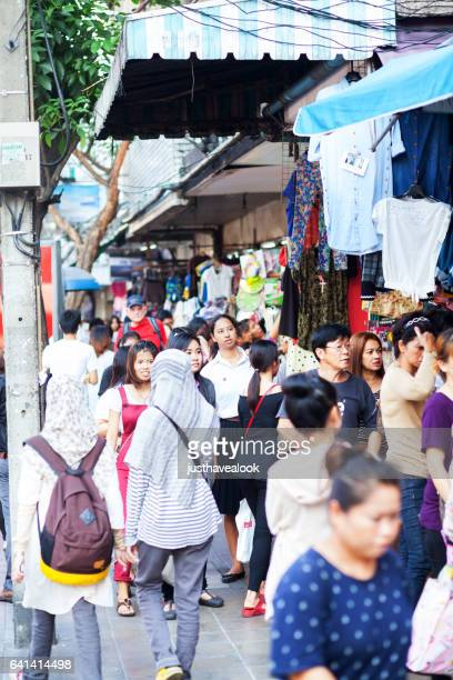 shopping scene at victory monument in bangkok - gehweg stock pictures, royalty-free photos & images