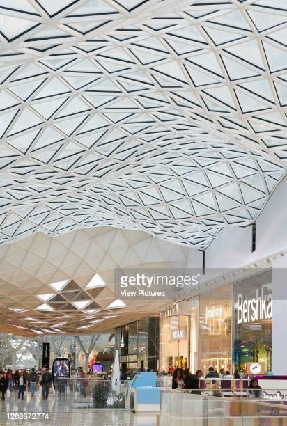 Shopping street beneath skylight. Westfield White City, London, United Kingdom. Architect: UNStudio, 2018.