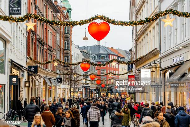 shopping street in historical center of copenhagen decorated for christmas holidays, denmark - pedestrian zone stock pictures, royalty-free photos & images