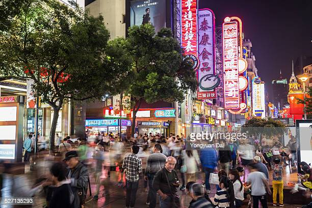 shopping street in shanghai at night - editorial stock pictures, royalty-free photos & images