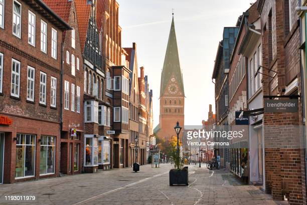 shopping street in the old town of lüneburg, germany - germany stock pictures, royalty-free photos & images
