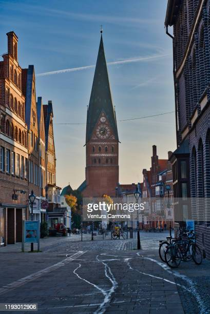 shopping street in the old town of lüneburg, germany - lüneburg stock pictures, royalty-free photos & images