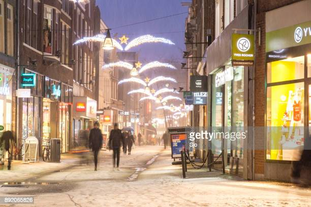 shopping street in zwolle during a cold winter night - zwolle stock pictures, royalty-free photos & images