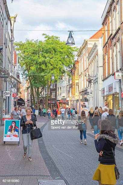 shopping street in zwolle with people looking at shop windows - zwolle stock photos and pictures
