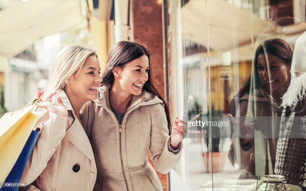 Shopping time. Young women shopping together. Consumerism, shopping, lifestyle : Stock Photo