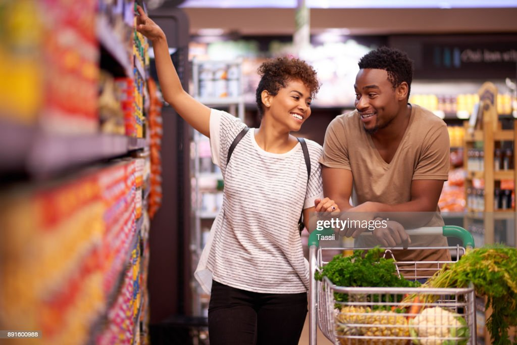 Shopping together for all their essentials : Stock Photo