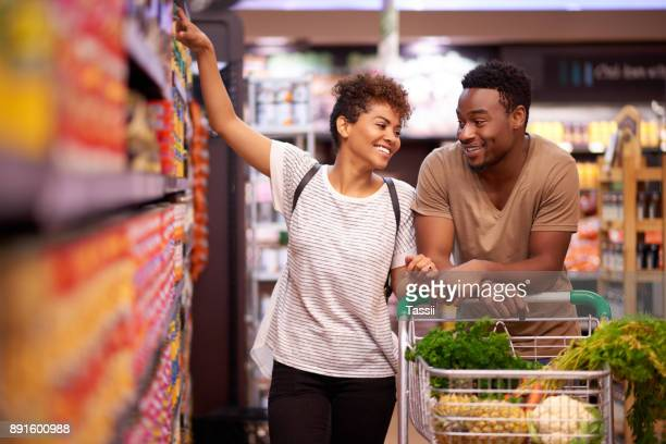 shopping together for all their essentials - buying stock pictures, royalty-free photos & images