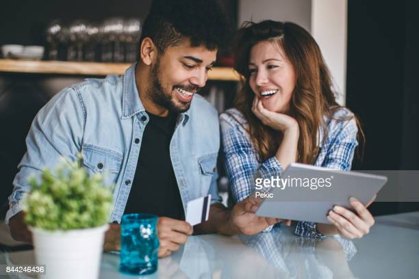 shopping together with fun - multiracial couple stock photos and pictures