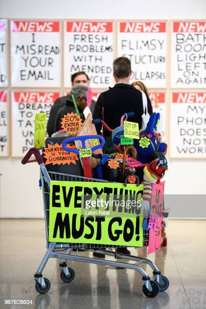 A shopping trolley filled with plastic goods titled 'Closing Down Sale' by Michael Landy is seen during a press preview of the 250th Summer...