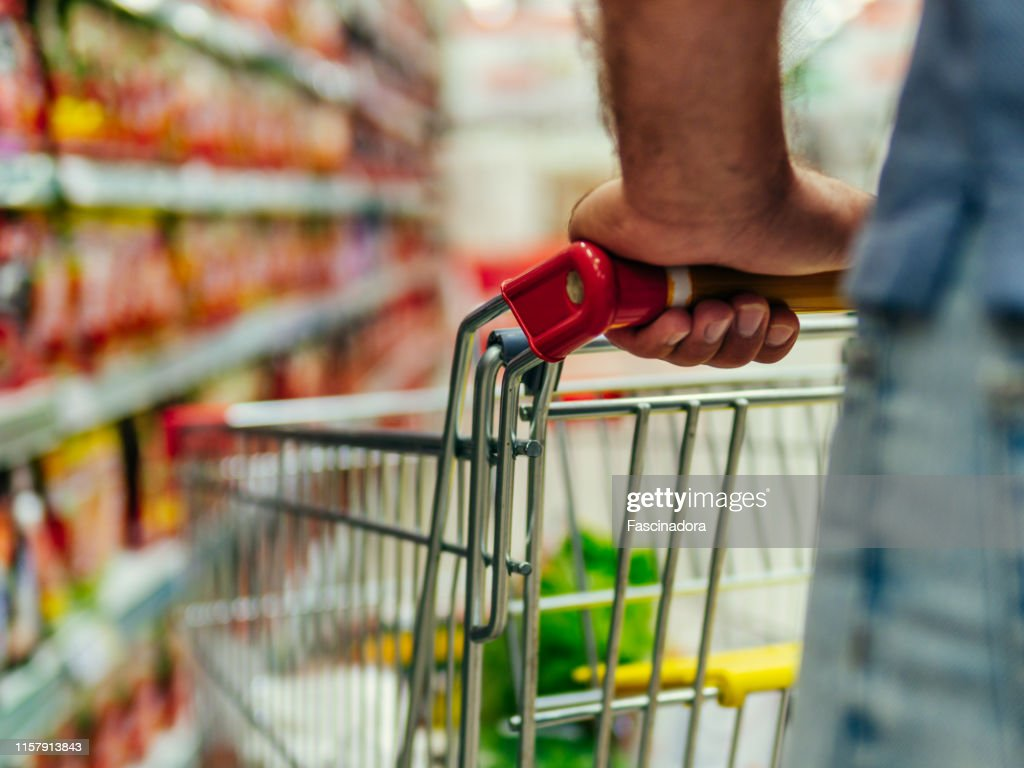 shopping trolley in supermarket aisle, copy space : Stock Photo