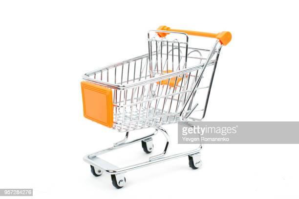 shopping trolley isolated on white background - mercado espaço de venda no varejo - fotografias e filmes do acervo
