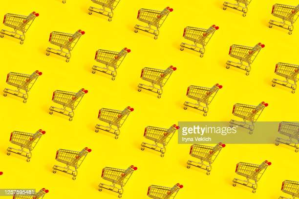 shopping trolley pattern on yellow background. - sale stock pictures, royalty-free photos & images