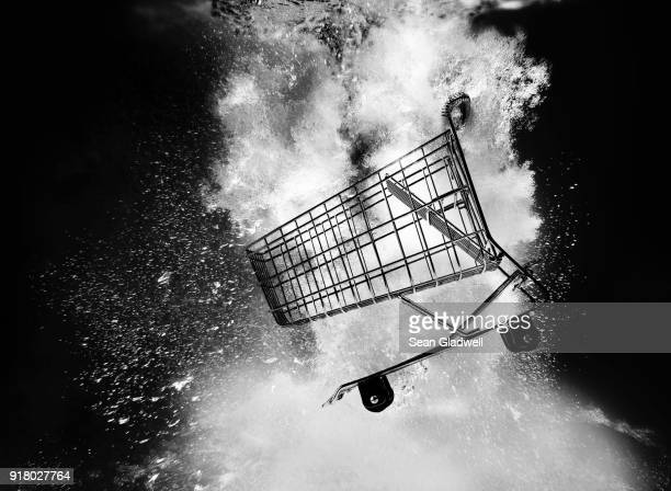 shopping trolley underwater - black friday stock photos and pictures