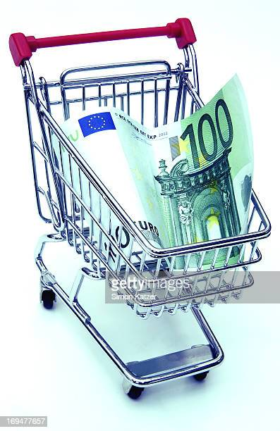 Shopping trolley with euro banknote