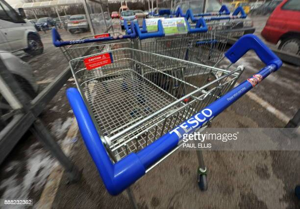 Shopping trolleys are pictured at a Tesco supermarket in Birkenhead northwest England on January 12 2010 Britain's biggest retailer supermarket group...