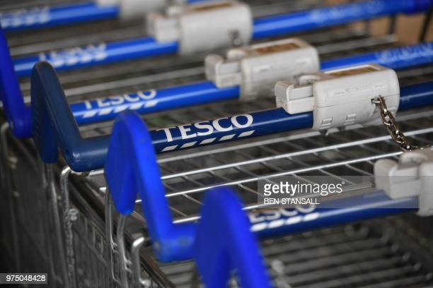 5f3f5f5ee4ba Shopping trolleys of British supermarket chain Tesco at a store in south  London on June 15