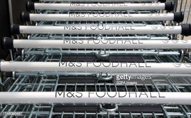Shopping trolleys seen lined up at a Marks Spencer store One of the Top Ten Supermarket chains / brands in the United Kingdom