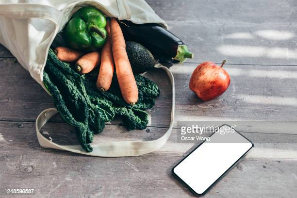 shopping vegan food with reusable shopping bag - sustainable resources stock pictures, royalty-free photos & images