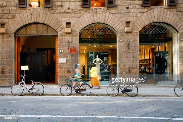 shopping versace florence italy - versace designer label stock photos and pictures