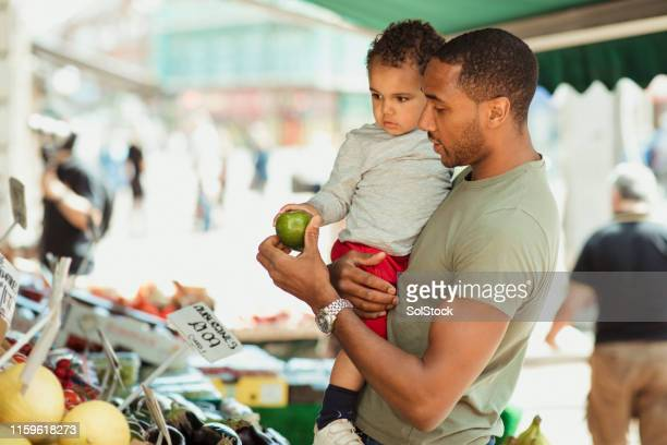 shopping with a healthy lifestyle - farmers market stock pictures, royalty-free photos & images