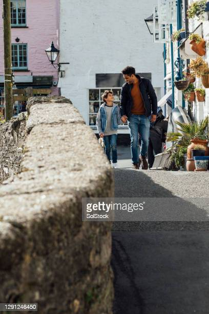 shopping with daddy - village stock pictures, royalty-free photos & images