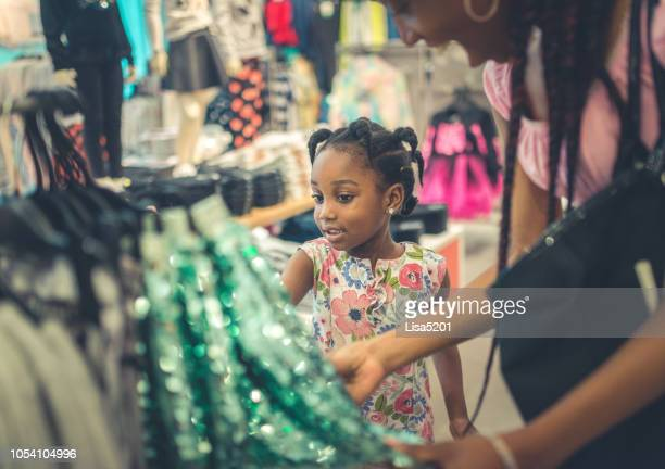 shopping with mom - clothing stock pictures, royalty-free photos & images