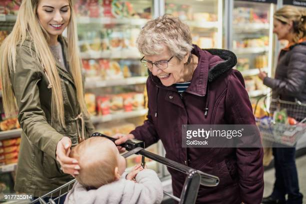 shopping with the family - british granny stock photos and pictures