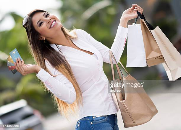 Shopping woman holding credit cards