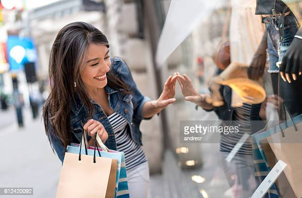 Shopping woman looking at a window